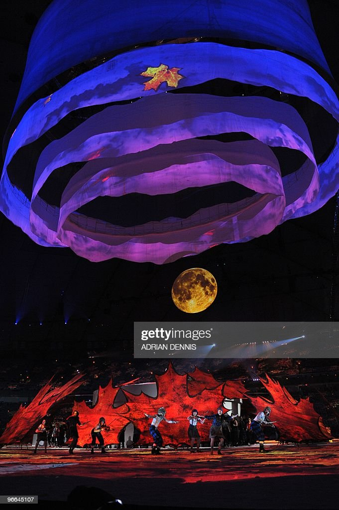 Fiddlers and dancers perform as they represent Canada's fiddling tradition and the colors of fall (Autumn) during the opening ceremony for the Vancouver Winter Olympics at BC place in Vancouver on February 12, 2010. The Games' build-up culminates with the lighting of the Olympic cauldron at BC Place in Vancouver, a ceremony held indoors for the first time in the competition's history.