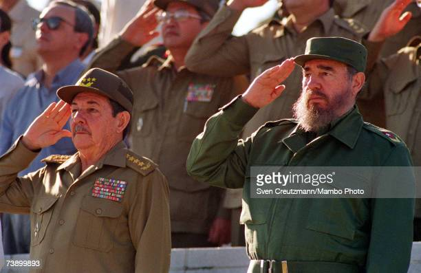 Fidel Castro and his brother Raul attend a parade December 2 1996 in Havana Cuba Carlos Lage is at left