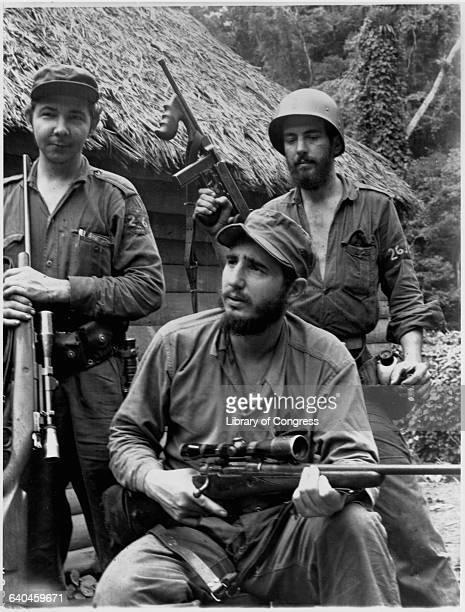 Fidel Castro and two guerillas bear rifles at their mountain hideout in eastern Cuba during the insurgency against the Batista regime | Location...