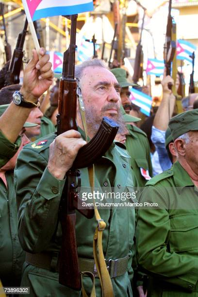 Fidel Castro carrying a Kalashnikov AK47 assault rifle before addressing the crowd in a speech to commemorate 40 years since he called for the Cuban...