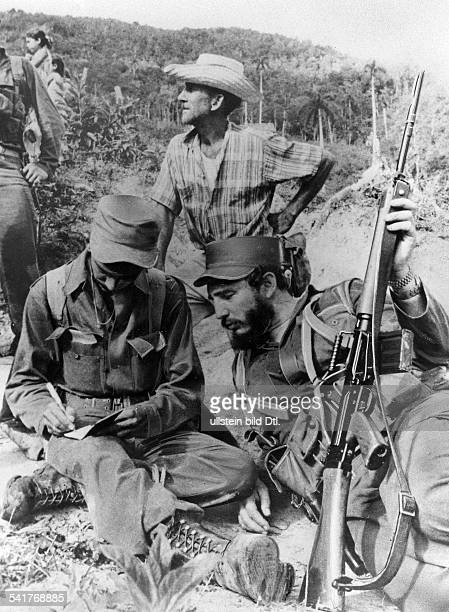 CASTRO AND CHE GUEVARA Fidel Castro Cuban revolutionary and head of state photographed next to Ernesto 'Che' Guevara in the Sierra Maestra mountains...
