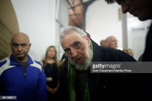 Fidel Castro Cuba's former President and revolutionary leader looks at the camera during a rare public appearance to attend the inauguration of an...