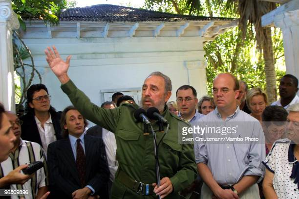 Fidel Castro , Cuba�s head of State and Party, gives a speech as he stands next to US Congressman Jim McGovern after signing a treaty between Cuba...