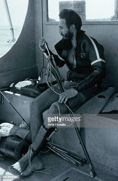 Fidel Castro examines a harpoon during an underwater dive off the coast of Cuba