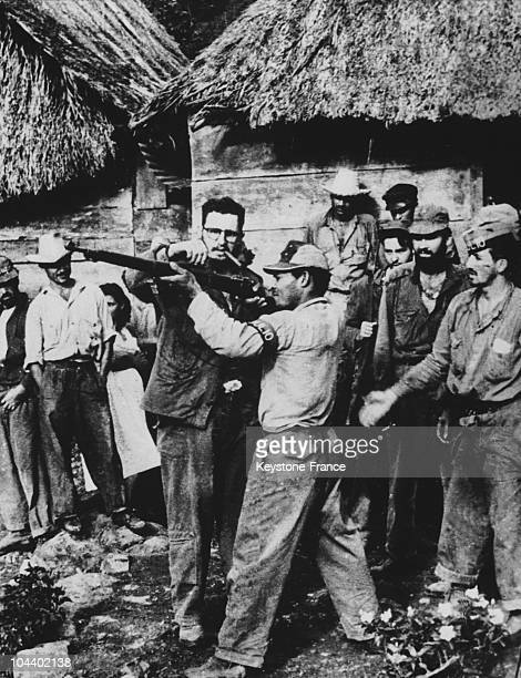 Fidel CASTRO giving firing instructions to guerrilla fighters who have come to join his armed forces in the Sierra Maestra a mountainous region in...
