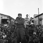 Fidel castro is shown here crossing his arms and surrounded by the picture id514968108?s=170x170