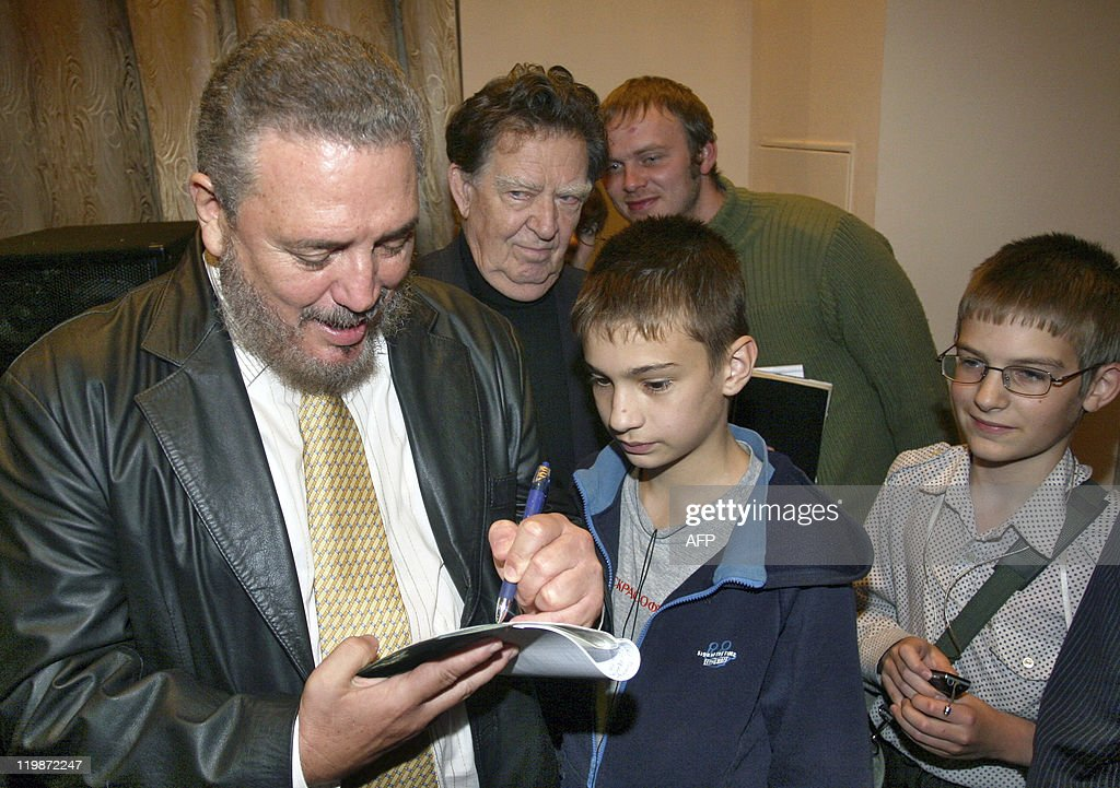 Fidel Castro Jr. signs an autograph for a child at a meeting with Nobel Prize Physicist Jores Alferov in St. Petersburg, 05 October 2007. Castro spoke to a group of elementary and university students at the request of Alferov. AFP PHOTO / SERGEY