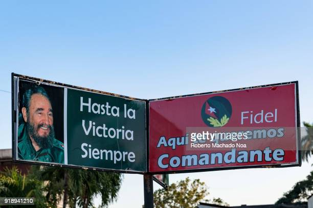 Fidel Castro photo with the signs 'Until Victory Forever' and 'Here We Love You Commandant' The Banner is seen on the Communist Party Provincial...