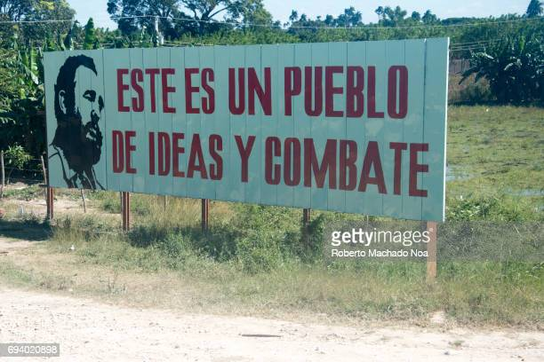 Fidel Castro quote in road billboard in Cuban countryside Large signboard with Spanish text written on it in a field
