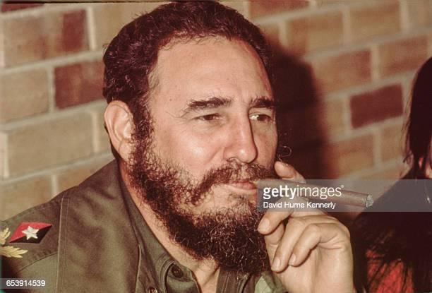 Fidel Castro smokes a cigar in his office in Havana Cuba circa 1977