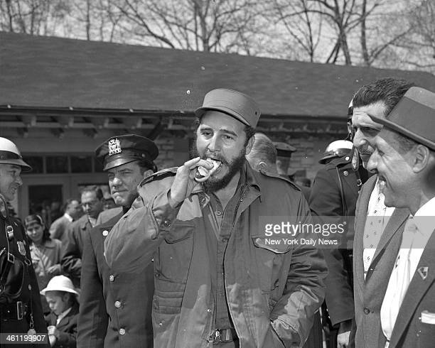 Fidel Castro takes a bite out of a hot dog at the Bronx Zoo