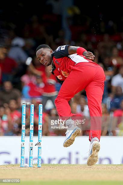 Fidel Edwards breaks the stumps to complete a run out during a match between The Trinidad and Tobago Red Steel and St. Lucia Zouks as part of the...