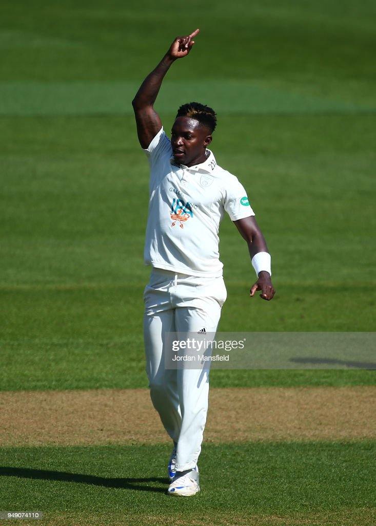 Fidel Edwards of Hampshire celebrates dismissing Rory Burns of Surrey during day one of the Division One Specsavers County Championship match between Surrey and Hampshire at The Kia Oval on April 20, 2018 in London, England.