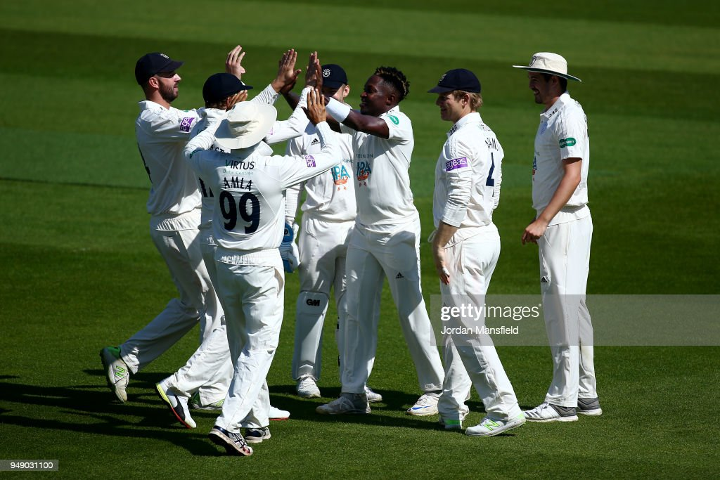 Fidel Edwards of Hampshire celebrates with his teammates after dismissing Scott Borthwick of Surrey during day one of the Division One Specsavers County Championship match between Surrey and Hampshire at The Kia Oval on April 20, 2018 in London, England.