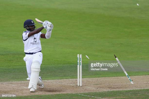 Fidel Edwards of Hampshire is bowled by Tom Curran of Surrey for 20 during day three of the Specsavers County Championship Division One match between...