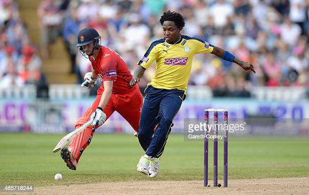Fidel Edwards of Hampshire tries to beat Karl Brown of Lancashire to the ball during the NatWest T20 Blast Semi Final between Hampshire Hawks and...
