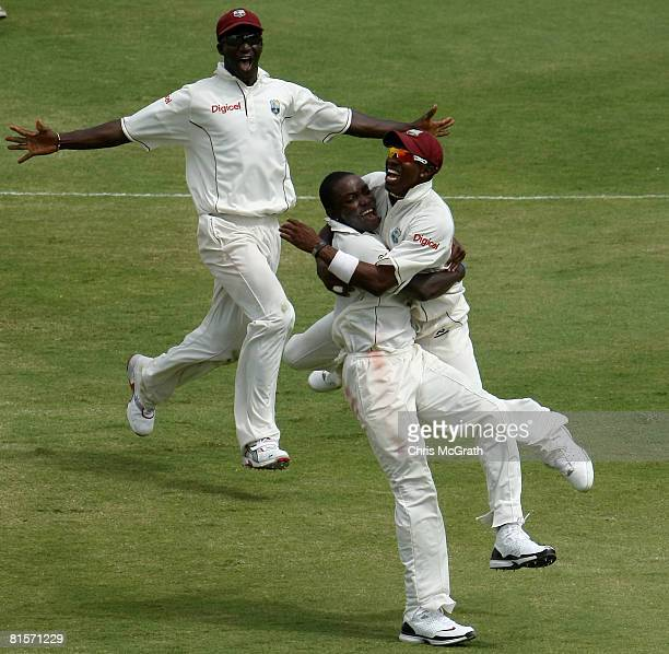 Fidel Edwards of the West Indies celebrates taking the wicket of Phil Jaques of Australia with team mates Dwayne Bravo and Darren Sammy during day...
