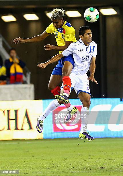 Fidel Martinez of Ecuador jumps for a header with Jorge Claros of Honduras during an international friendly match at BBVA Compass Stadium on November...