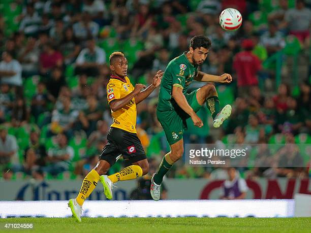 Fidel Martinez of Leones Negros and Oswaldo Alanis of Santos fight for the ball during a match between Santos Laguna and Leones Negros as part of...