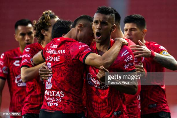 Fidel Martinez of Tijuana celebrates after scoring the second goal of his team during the 14th round match between Club Tijuana and Mazatlan FC as...