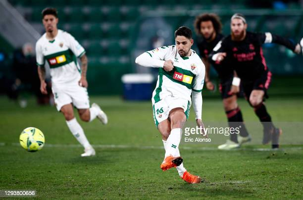 Fidel of Elche scores their team's first goal from the penalty spot during the La Liga Santander match between Elche CF and Real Madrid at Estadio...