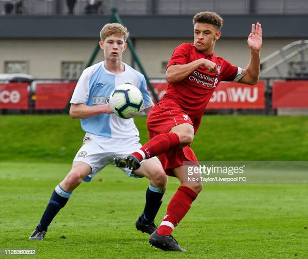 Fidel O'Rourke of Liverpool and Jake Garrett of Blackburn Rovers in action during the U18 Premier League game at The Kirkby Academy on March 2 2019...