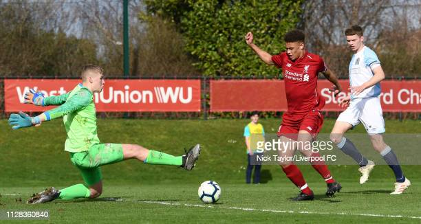 Fidel O'Rourke of Liverpool and Lewis Thomas of Blackburn Rovers in action during the U18 Premier League game at The Kirkby Academy on March 2 2019...