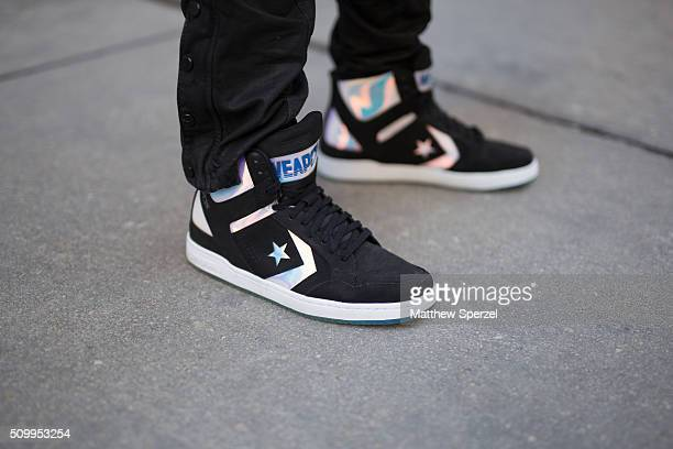 Fidel Rodriguez is seen on Rush Street wearing Dolce Gabbana glasses offwhite Zara coat black Ralph Lauren pants and black/white Converse sneakers on...