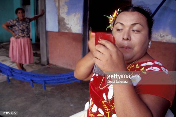 Fidela Gomez Castillo, 43 years old, and Mistica Sonenez Gomez, 25 years old laugh in Juchitan, Mexico, October 1, 2002. In the sleepy southern...