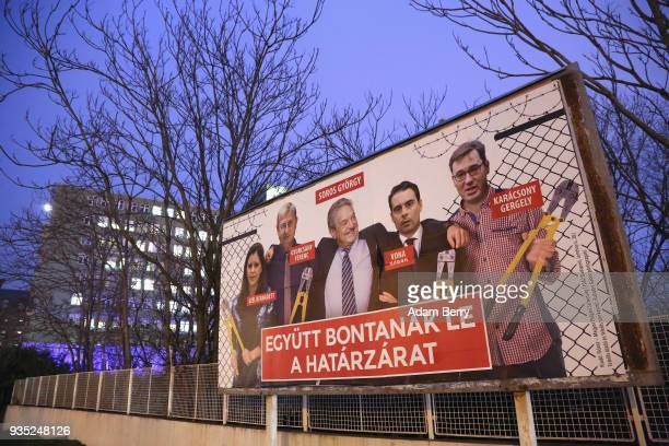 Fideszparty sponsored poster featuring a montage of billionaire investor George Soros posing with Politics Can Be Different party candidate Bernadett...