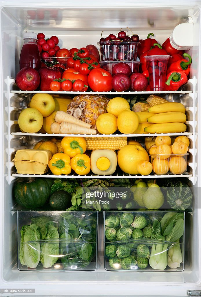 Fidge filled up with vegetables and fruit sorted by colour : Stock Photo
