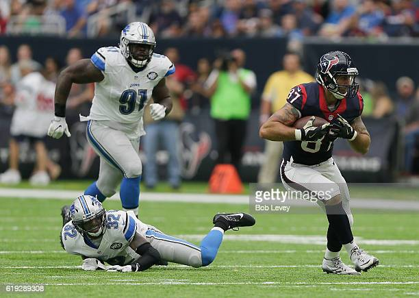 J Fiedorowicz of the Houston Texans breaks the tackle attempt by Tavon Wilson of the Detroit Lions as Armonty Bryant pursues at NRG Stadium on...