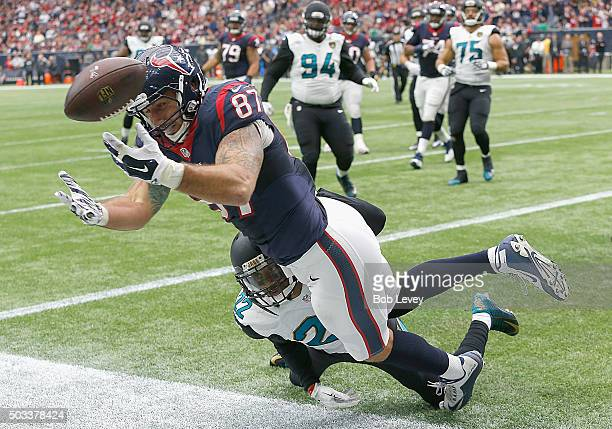 J Fiedorowicz of the Houston Texans can't hold onto the ball as he his pushed out of bounds by Aaron Colvin of the Jacksonville Jaguars at NRG...