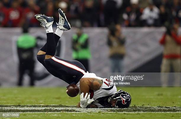 J Fiedorowicz of the Houston Texans fumbles the ball after a hard hit by Reggie Nelson of the Oakland Raiders in their game at Estadio Azteca on...