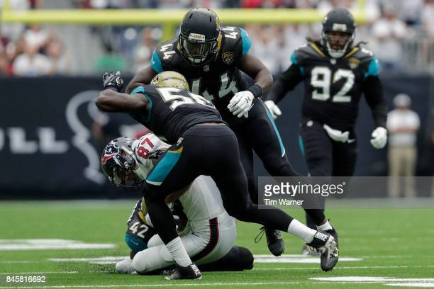 J Fiedorowicz of the Houston Texans is tackled by Myles Jack and Barry Church of the Jacksonville Jaguars in the third quarter at NRG Stadium on...