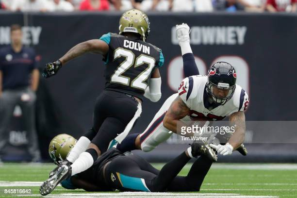 J Fiedorowicz of the Houston Texans is tackled by Myles Jack of the Jacksonville Jaguars in the second quarter at NRG Stadium on September 10 2017 in...