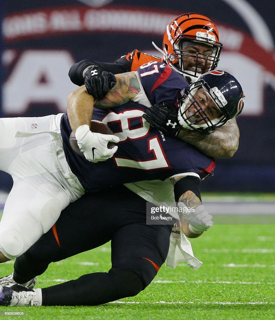 C.J. Fiedorowicz #87 of the Houston Texans is tackled by Rey Maualuga #58 of the Cincinnati Bengals in the second quarter at NRG Stadium on December 24, 2016 in Houston, Texas.