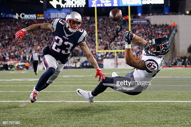 J Fiedorowicz of the Houston Texans misses a catch while under pressure by Patrick Chung of the New England Patriots in the first half during the AFC...