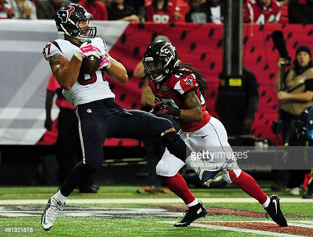 Fiedorowicz of the Houston Texans scores a touchdown against Dezmen Southward of the Atlanta Falcons in the second half at the Georgia Dome on...