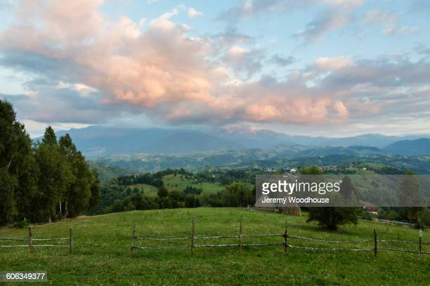 Field and mountains in rural landscape