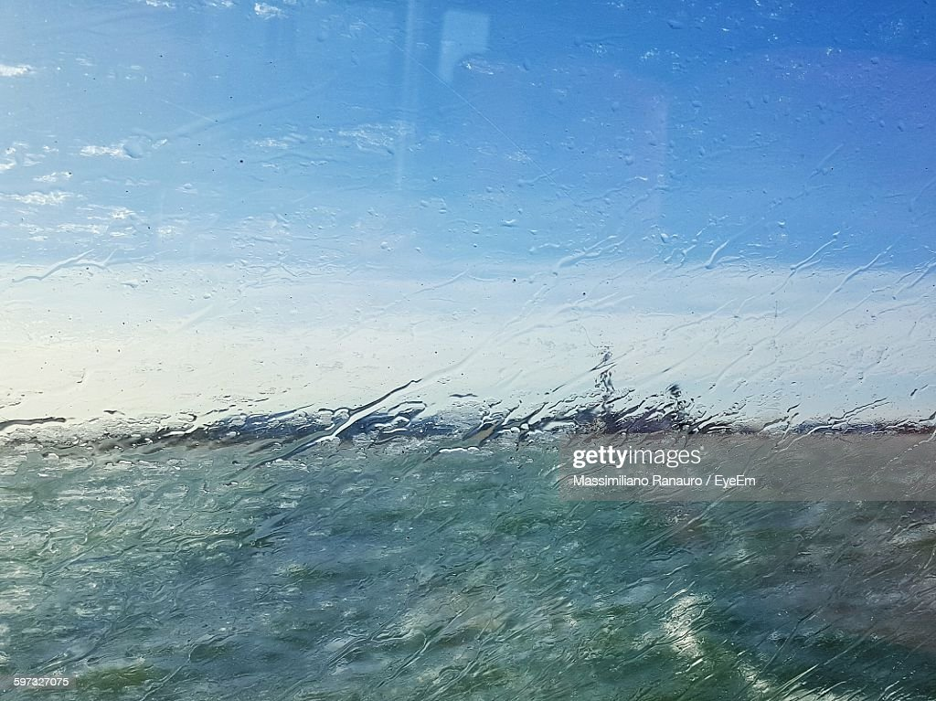 Field And Sky Seen Through Wet Glass Window : Stock Photo