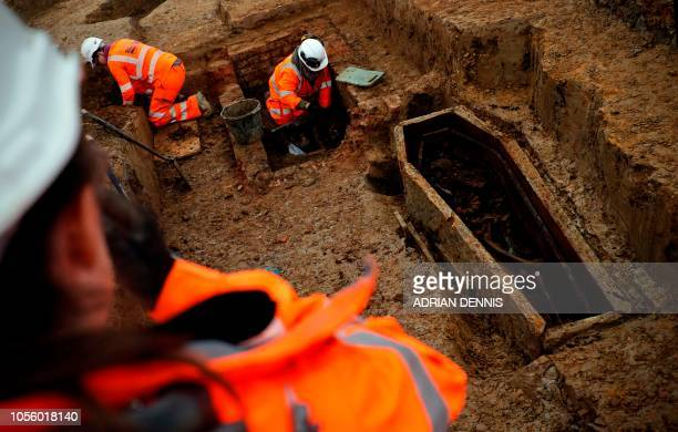 Field archaelogists work on the excavation of a late 18th to mid 19th century cemetery under St James Gardens near Euston train station in London on...