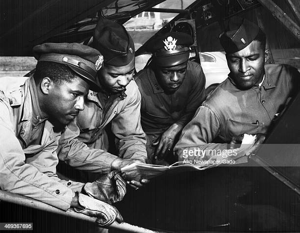 Field Artillery Officers and Tuskegee Airmen Elwood A Smith Scott K Cleage Sterling K Jackson and Wendel Long complete pre flight checks on an...