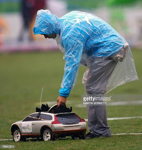Field assistant puts a discus in a remote control car during the Men's Discus Throw at the XV Pan American Games 2007 in Rio de Janeiro, Brazil, 28...