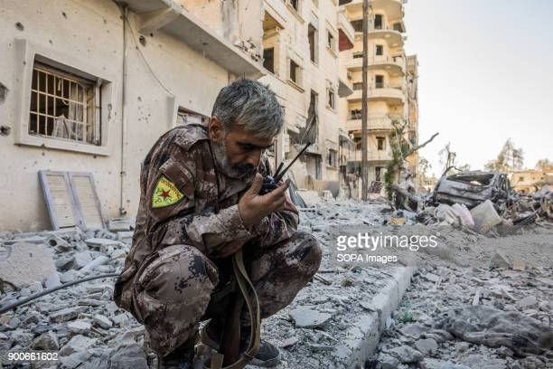A field commander of YPG heard on walkie talkie the news of his son who severely injured in Raqqa frontline The Syrian civil war has been carried on...