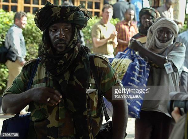 SLA field commanders Jurelnabi Abdelkarim Ibrahim Mohamed Nassir and Salah Adam Issak arrive at the Ngordoto hotel Arusha August 2007 on the second...