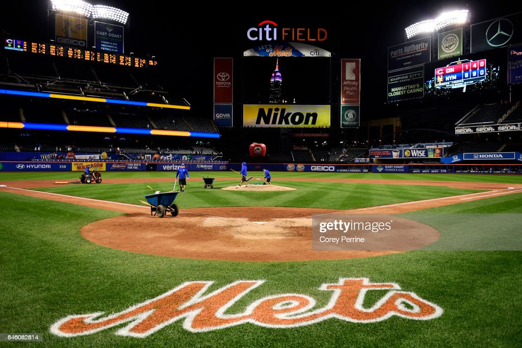 Field crew members prep the field after the New York Mets win over the Cincinnati Reds at Citi Field on September 9, 2017 in the Flushing neighborhood of the Queens borough of New York City. The Mets won 6-1.