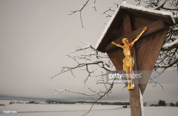 Field cross depicting the crucifixion of Christ stands in a snowy landscape of the Bavarian Prealps near the ham of Issing on January 23, 2007 in...