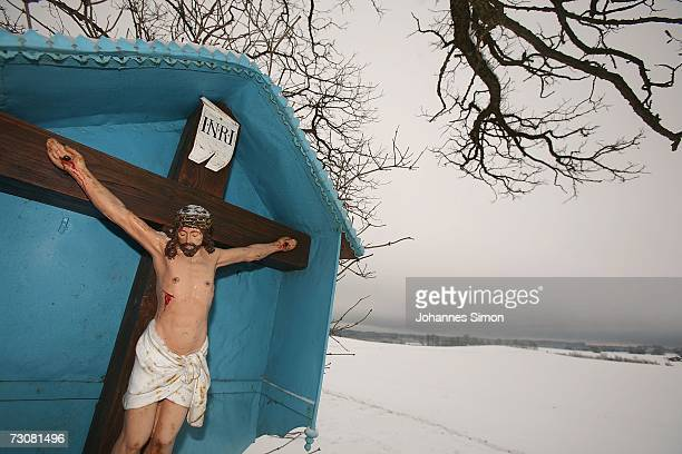 Field cross depicting the crucifixion of Christ stands in a snowy landscape of the Bavarian Prealps near the ham of Rott on January 23, 2007 in...