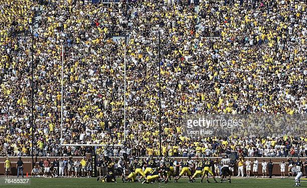 Field goal kicker Jason Gingell of the University of Michigan attempts a field goal in the fourth quarter to give the Michigan Wolverines the lead at...